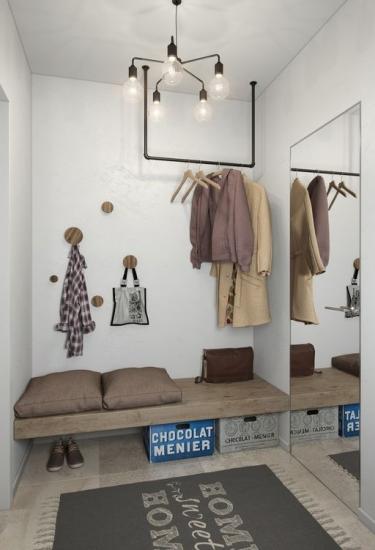 Si necesitas hacer de tu recibidor un pequeño vestidor hazlo con mesura y clase_via Casaydiseno.com